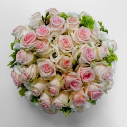 Funeral posy pad in pink roses