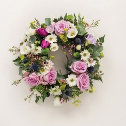 Funeral wreath in purple and white