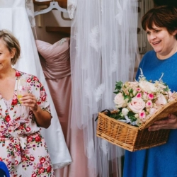 Delivering the bouquets to the bridal party